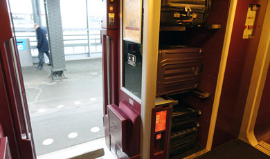 Luggage on Thalys goes on the racks just inside the door.