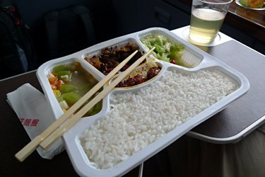 Complimentary tray meal in business class