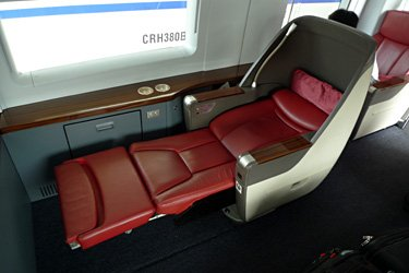 The business class seats recline to become a flat bed