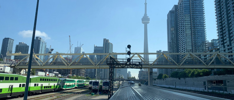 Looking back at the CN Tower as the train to Vancouver leaves Toronto