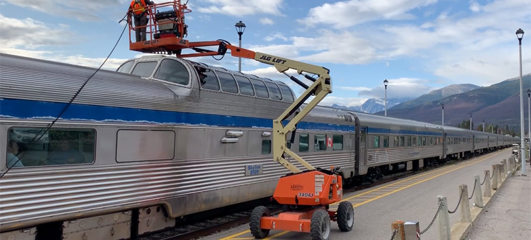 The train's dome windows are cleaned at Jasper