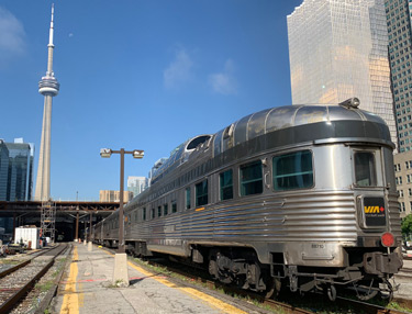 "Under the CN Tower, ""The Canadian"" trans-continental train waits to leave Toronto..."