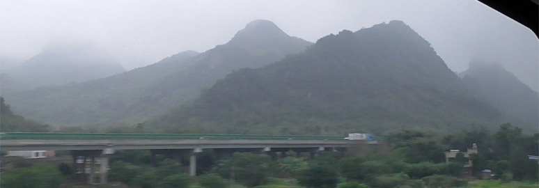 Misty mountain scenery from the Hong Kong to Beijing train