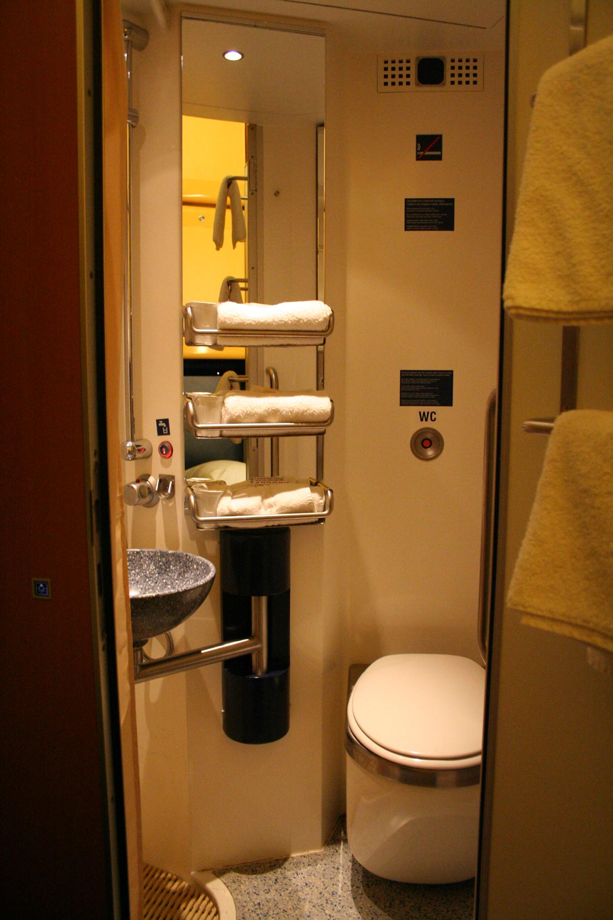 The toilet & shower in a deluxe sleeper.