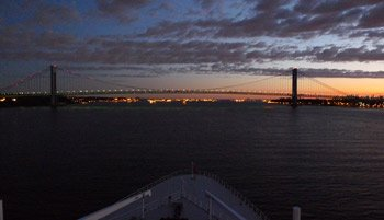 At the end of a transatlantic crossing, the Queen Mary 2 approaches the Varrazano Narrows suspension bridge