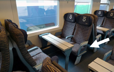 2nd class table for 4 shwoing luggage space between seats